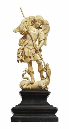 A CARVED IVORY GROUP OF SAINT MICHAEL SLAYING THE DRAGON -  ITALIAN, FIRST HALF 18TH CENTURY.