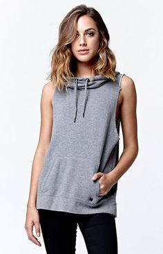 Online Only! Get cozy and casual in the Seaside Funnel Muscle Pullover Hoodie from Hurley. This pullover hoodie features a muscle silhouette, soft French terry fabric, sleeveless design, and kangaroo pockets to keep hands secure. Wear this pullover hoodie with our jogger shorts or jeans.   	French terry fabric 	Large funnel hood 	Sleeveless, raw edge hem 	Kangaroo pockets 	Hurley icon charm at bottom of pocket 	Model is wearing a size small 	80% cotton, 20% polyester 	Machine washable…