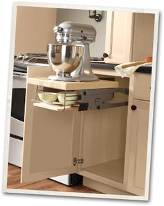 These pull out mixer stands are popping up everywhere.  Pretty smart!