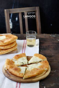 Hungarian Langos are deep fried flat bread that is served warm and topped with sour cream and grated cheese or garlic butter. Hungarian Cuisine, Hungarian Recipes, Hungarian Food, My Recipes, Cooking Recipes, Favorite Recipes, Queso Frito, European Dishes, Molecular Gastronomy