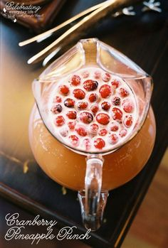 Cranberry Pineapple Punch  |   2 cup Cranberry Juice  2 cup Pineapple Juice  4 cups Ginger ale  whole, fresh cranberries
