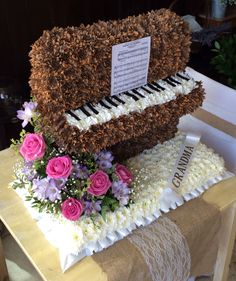 Custom funeral flower upright standing piano tribute