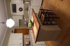 DIY kitchen island from unfinished base cabinets, beadboard, trims and corbels