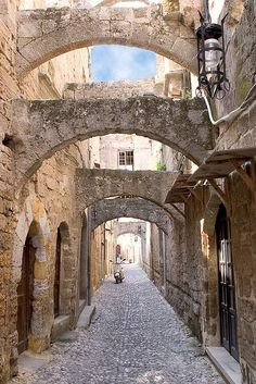 Greece Travel Inspiration - Ancient city of Rhodes, Greece. I am fascinated by this city of the Templar Knights. The old houses of the countries that the knights were from can still be seen. The city is a walled city with a beautiful harbor that the Colossus of Rhodes stood guarding the harbor