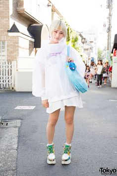 Ene on the street in Harajuku wearing a sheer jacket from Wagado Tokyo over a unicorn dress, a Nile Perch bag, and Yosuke platforms. Full Look Asian Street Style, Tokyo Street Style, Japanese Street Fashion, Tokyo Fashion, Harajuku Fashion, Kawaii Fashion, Street Style Women, Street Styles, Harajuku Style