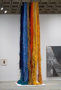 Whitney Biennial  Installation view of Pillar of Inquiry/Supple Column, 2013-14 by Sheila Hicks and Notley, 2013 by Molly Zuckerman-Hartung.
