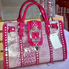 Metallic Croc Embossed with Rhinestones - Pink Just gorgeous! Metallic faux croc embossed print satchel with Rhinestone and buckle accent. Zipper top opening, flap over top with magnetic snap closure, metal feet on bottom.  Includes bonus chain shoulder strap. Bags Satchels