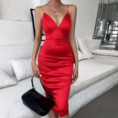 """When you're looking to feel soft and sultry, you're going to love having a dress like this satin midi dresses."" #backlessbodycondress #satinmididress"