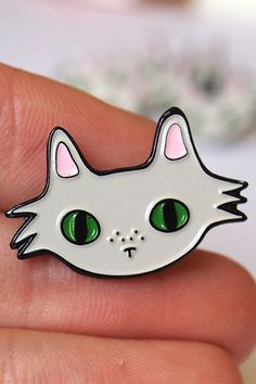 Wish List // 6 Cute and Wonderful Items for Cat Lovers by @arosecast - Cat-themed objects, from lapel pins and patches to notebooks, art prints and greeting cards by Toby at I Like CATS. This lapel pin of a grey cat with green eyes is adorable.