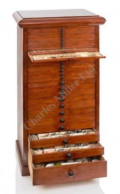 FROM THE COLLECTED PROPERTY OF THE LATE MR L. MOLE, A LARGE COLLECTOR'S CABINET, CIRCA 1880, constructed in stained pine and comprising 20 x 64-compartment microscope slide drawers for 1, 280 slides, and containing approx. 600 professionally and privately prepared slides many dated for between 1870 and 1884; a further 15 graded specimen drawers containing a large amount of natural history including fossils and minerals, possible owner's inscription reading W.A. Bell May 12th 1880 to top…