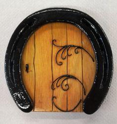 Horseshoe fairy / troll / hobbit door with soldered copper scroll