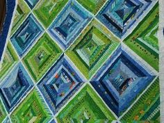 strip quilt in blue and green