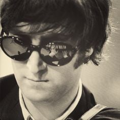 I love the reflection of him playing piano in his sunglasses