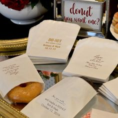 Flat, wax-lined paper favor bags personalized with a design, the bride and groom's name and wedding date make perfect favor bags for your wedding reception donut bar. Guests can slide a donut into a bag to take home and enjoy later. These favor bags can be ordered at http://myweddingreceptionideas.com/wedding_cake_candy_favor_bags.asp