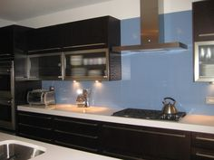 glass backsplashes – no seams, no grout, easy to clean—what more