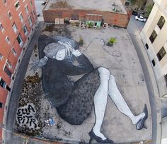 Artists Paint Sleeping Giants On Rooftops You Can Only See From Above