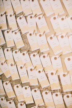 escort cards with a pop of gold, photo by Jen Rodriguez http://ruffledblog.com/half-moon-bay-california-wedding #weddingideas #seatingchart
