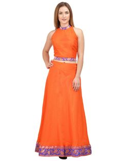 Flaunt your toned Skin in the most attractive manner by wearing this Orange skirt With Orange crop top by Castle. Simple and classy in design, this flared skirt is also extremely soft against the skin, courtesy the fine dupion silk fabric.