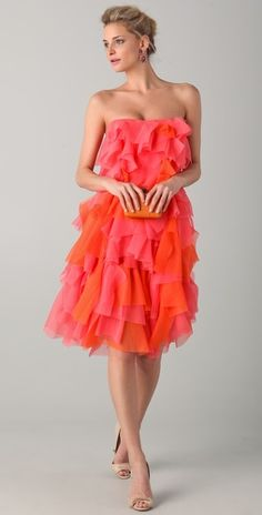 orange and coral strapless dress. Love the thought of the ruffles fluttering in the summer breeze!