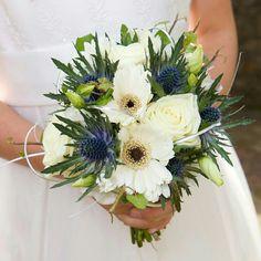 White Gerbera Daisies, White Roses, Lisianthus Buds, Blue Eryngium Thistle Wedding Bouquet
