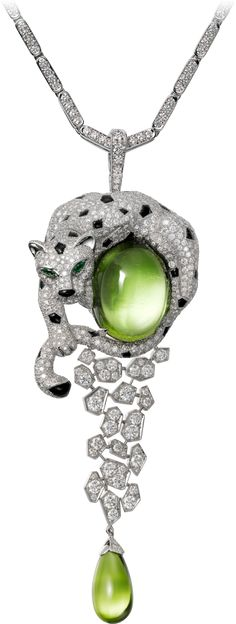 CARTIER. {Close up} Necklace - white Gold, one 32.53-carat oval-shaped cabochon-cut Peridot, one 10.11-carat Peridot drop, Onyx, Emerald eyes, brilliant-cut Diamonds. Étourdissant Cartier 2015  High Jewellery Collection.
