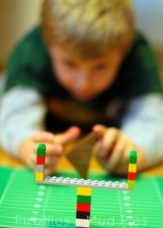 Exercise fine motor skills and use Legos to build a field goal to flick paper footballs over during games! - Fireflies and Mud Pies