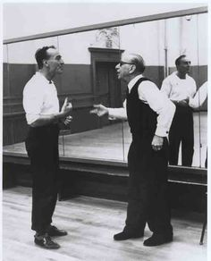 """Balanchine (left) and Stravinsky discuss """"Agon,"""" circa 1957.    Photo by Martha Swope/©NYPL for the Performing Arts"""