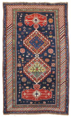 A Kazak long rug, Southwest Caucasus,  approximately 9ft. 8in. by 5ft. 4in. (2.95 by 1.62m.) circa 1900