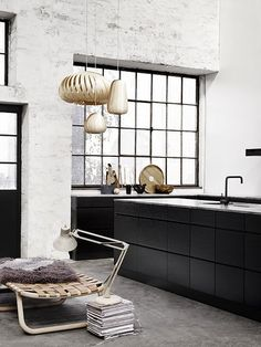 Exposed concrete slab, black joinery & black mixer... Just beautiful!