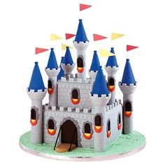 Medieval Fortress Castle Cake - Opt for realism when using our Romantic Castle Cake Set. Use our Embosser/Cutter to etch stone patterns into gray fondant walls that cause colorful turrets, windowsills and pennants.