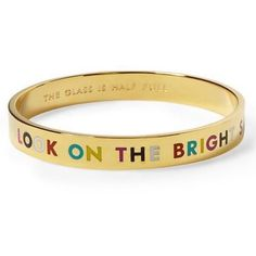 "Kate Spade Look on the Bright Side Gold Bracelet Kate Spade ""Look on the Bright Side"" idiom bracelet in gold with rainbow lettering. New w/out tag. Never worn--but there are a few super tiny marks most likely from when this bracelet was still in the store. I assure you that they are not noticeable. My camera wouldn't even pick them up. Comes with drawstring pouch. The inside is engraved with ""The Glass is Half Full.""This bracelet is a stylish affirmation of positivity and optimism! No…"