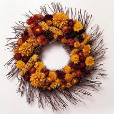 Corncobs-and-Flowers Fall Wreath        This wreath looks like a beautiful autumn sun radiating fall color. Hot-glue dried corncobs and flowers onto a heavy cardboard form that's been covered with Spanish moss. Use sturdy U-shape wire to join the wreath with a spindly twig wreath.