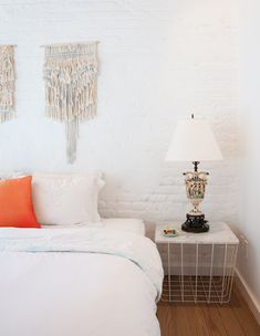 """""""ALL WHITE EVERYTHING,"""" Dana says. """"My cousin Hila is studying fashion in Barcelona and I begged her to go pick up these wall weavings from an artist there named Belen Senra (Ran Ran Designs). She had to bring them to NYC in her suitcase for me. That's what family is for!"""""""