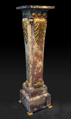 This Louis XVI style sellette was made in Peach Flower marble and gilded bronze in the 19th century.