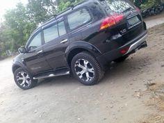 Mitsubishi Pajero sport with off road wheels