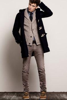 Shop this look on Lookastic: https://lookastic.com/men/looks/duffle-coat-shawl-cardigan-long-sleeve-shirt-jeans-boots-tie-belt/5042 — Brown Suede Boots — Brown Jeans — Dark Brown Leather Belt — Blue Polka Dot Long Sleeve Shirt — Black Tie — Grey Shawl Cardigan — Navy Duffle Coat