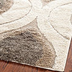 @Overstock - This power-loomed shag area rug easily matches a variety of interior decors, thanks to its use of a cream background and smoke accents. Polypropylene and canvas materials make the rug durable.http://www.overstock.com/Home-Garden/Hand-woven-Ultimate-Cream-Smoke-Shag-Rug-8-x-10/5665235/product.html?CID=214117 $246.84