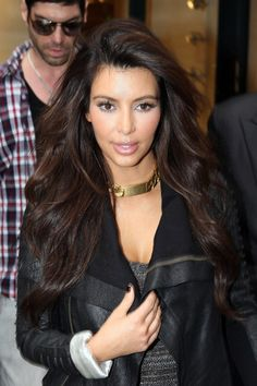 I love Kim's hair in this photo, gonna make this my Summer look...lol