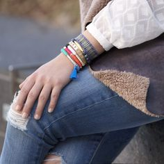 An arm party gets a bohemian feel with the addition of texture and bright hues. #stitchfix
