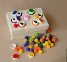 """Toss the """"ball"""" up high in the air above the box to get them in the holes."""