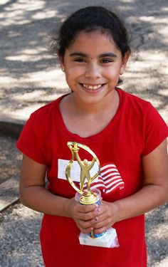 Emory shows off a trophy she won at the church picnic. She is a member of AWANA, Paladin Martial Arts (purple belt), our after school club and summer camp. Emory will be entering 3rd grade at Highland Park Gifted and Talented Academy.
