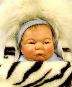 $189 and this Berenguer Special Edition Reborn Baby boy Doll not only looks creepy, but like a crotchety old man.  Lmao