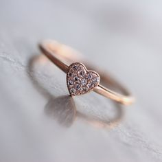 On the more expensive side... Tiny Sparkly Rose Gold Heart Ring White Topaz by NangijalaJewelry