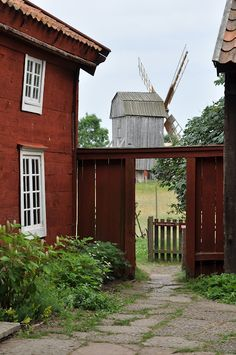 red siding, white windows... and a windmill!
