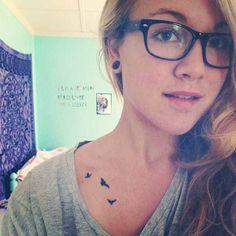 Elegant little bird tattoo on neck