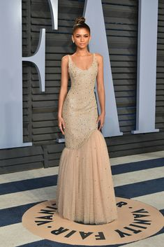 Zendaya & Tom Holland Switch Things Up at Oscars After Party!: Photo Zendaya looks so glamorous in her nude-colored gown at the 2018 Vanity Fair Oscar Party at the Wallis Annenberg Center for the Performing Arts on Sunday night (March… Zendaya Coleman, Zendaya Outfits, Zendaya Style, Zendaya Dress, Zendaya Fashion, Moda Zendaya, Party Fashion, Fashion Outfits, Fashion Pics