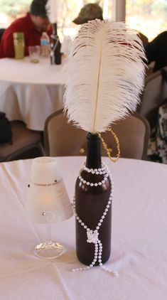 Awesome New Years Eve Party Ideas and Decorations – Great Gatsby Health & Fitness – Grandcrafter – DIY Christmas Ideas ♥ Homes Decoration Ideas Roaring 20s Party, 1920s Party, Great Gatsby Party, 1920s Theme, Gatsby Theme, Gatsby Wedding, Gran Gatsby, Feather Centerpieces, Bottle Centerpieces