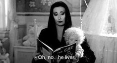 Morticia Adams checking out the Cat in the Hat!