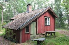 Falu red stuga (cottage) and vedbod (woodshed) built in Sweden by Gustav Larsson's great-grandfather in the 1950s