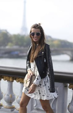 A girly black and white dress with a edgy leather jacket. Great outfit idea.